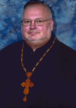ЦЮРПІТА, отець Джон